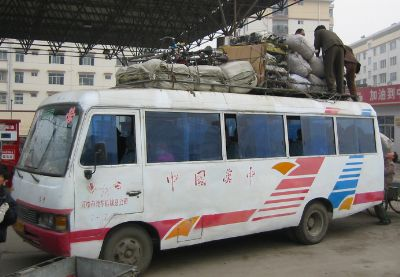 Typical Chinese long distance bus. Note the careful packing