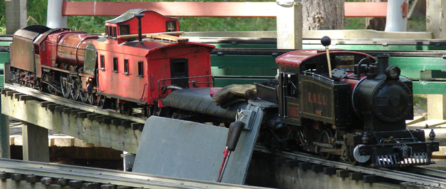 Richmond Hill Live Steamers steam locomotive no. 6883 and Whitchurch Highland Railway caboose no. 89567.  Unlike trains of today, these retain the tradition of having a caboose.