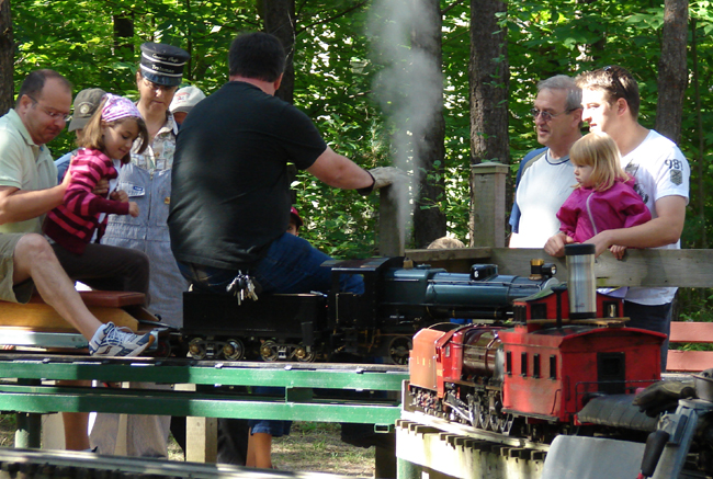 Richmond Hill Live Steamers let off steam: Smaller gauge track, propane powered boiler but still steam powered, for a cleaner running engine. That little girl's attention is fully occupied.