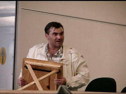 Robert Dziekanski holds a small table at the Vancouver Airport in this image from video. He was then killed by the RCMP.