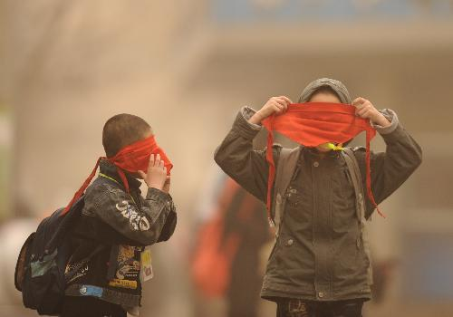 These boys have the right idea, using their hong lingdai as a mask. Lanzhou, Gansu, China by Xinhua