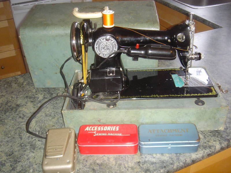 Imperial sewing machine, model 703 from CL, April 25 2010, Calgary, Alberta, Rocky View No. 44, AB T3Z 3L2, Canada. Note the attachments and accessories cases and foot pedal are similar to other Imperials.