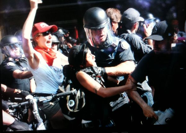 Toronto Police grab a women by the throat, College and Yonge, Toronto G20