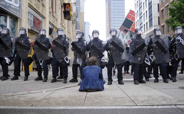 Toronto riot police intimidate as a protester taunts them