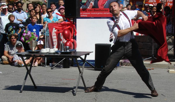 Toronto Buskerfest 2010: Mat Ricardo's Grand Finale was to launch a diabolo 3 stories in the air, pull the table cloth from the table without messing up the China and silverware, then catch the diabolo with the tablecloth