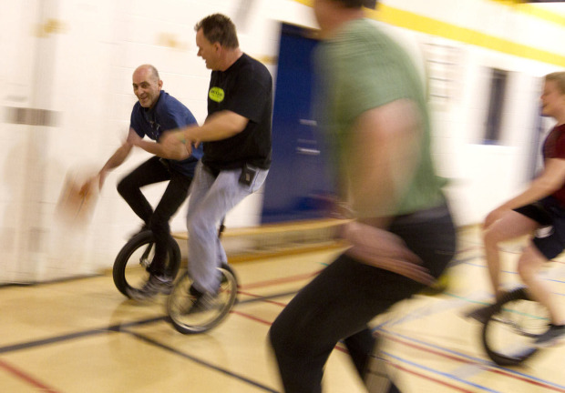 Nick (left) and Darren Bedford (right) and the Toronto Unicyclists play unicycle basketball at St. Josaphat Catholic School, Toronto, Canada