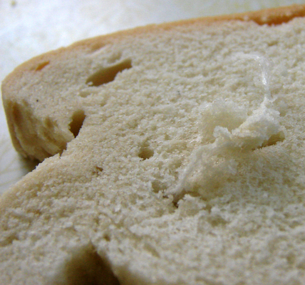 Foreign fiber objects found embedded into Ralph's Hard Dough bread, Toronto, Canada, Photo by Don Tai
