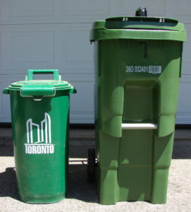 The new Toronto Green bin is much larger than the old, both taller and wider. I'd call the colour puke. Front view. Photo 1 by Don Tai.