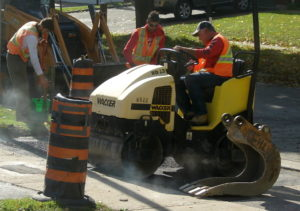 Boulevard repaving, Toronto, Canada. The boulevard asphalt on my neighbours house is compressed by a roller machine. Photo8 by Don Tai