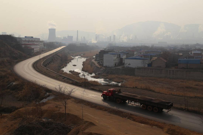Songting Village, looking east to Qian'an City and numerous large steel mills that burn coal and pollute the air and their water supply.