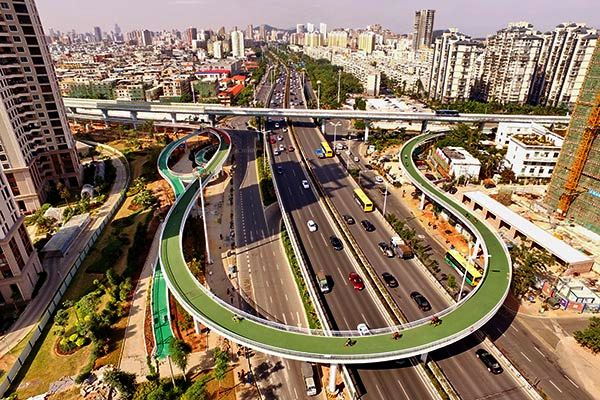 Bicycle path over highway overpass, Xiamen, Fujian province, Feb 9, 2017. The overpass looks long, but the length allows a gradual ascent and decent for cyclists, improving safety