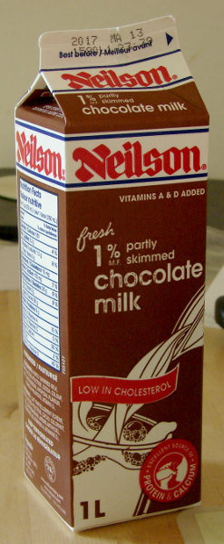 Neilson 2% Chocolate Milk, paper carton, I cannot open it without a knife. Terribly inconvenient. Toronto, Canada. photo by Don Tai