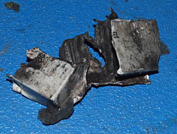 The Manchester Bomber used a Yuasa 12v 2.1aH lead acid battery. Here is what remains of the plastic case. You can see a faint OG on the left panel