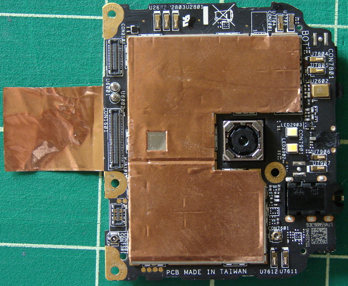 Asus Zenfone 2 Z00ADA ZE551ML, camera circuit board, front facing camera side. The copper tail sticker adheres to under the battery. Photo 4 by Don Tai