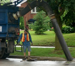 City of Toronto uses a specialty sewer sucking truck to clean the sewers. Worker uses a pick axe to remove the grate, plunges the crevice tool down the hole, sucks the garbage out. It takes only about 2 minutes max. Toronto, Canada. Photo 1 by Don Tai