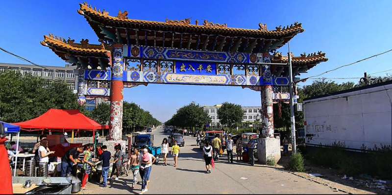 China, Beijing, Daxing, Xinjian Cun, before the demolition, where the government has destroyed the neighborhood of migrant workers and evicted everyone. South gate. Baidu