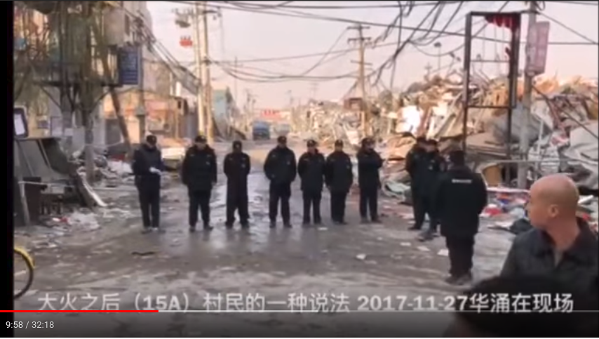 China, Beijing, Daxing, Xinjian Cun, after demolition, where the government has destroyed the neighborhood of migrant workers and evicted everyone. Heavy police presence. S of the North Gate. Youtube, Hua Yong