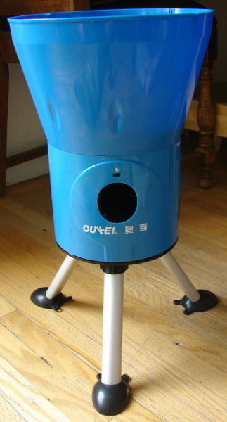 The Oukei TW-2700-E1 Table Tennis Training Machine is a consumer grade serving machine. It stopped working due to an out of aligned spring. Photo 1 by Don Tai