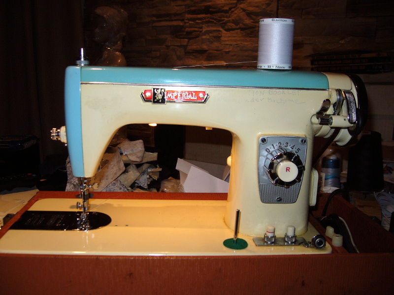Imperial sewing machine model 835 in blue, front view. Photo 1 by StaceyM.