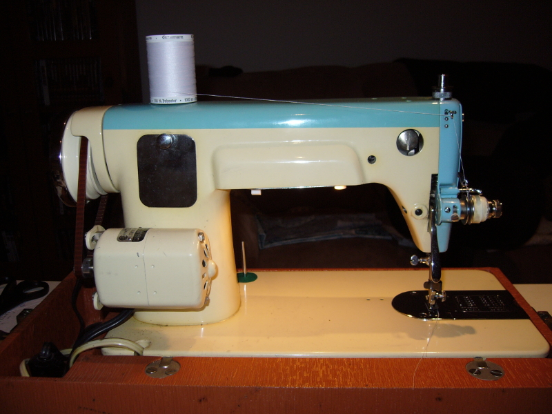 Imperial sewing machine model 835 in blue, rear view. Note the rear maintenance door and motor. Photo 2 by StaceyM.
