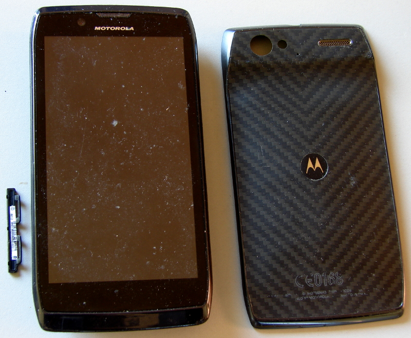 Motorola Droid Razr XT912 smartphone, battery puffed, cannot power up, boot loop and therefore dead. Photo 1 by Don Tai