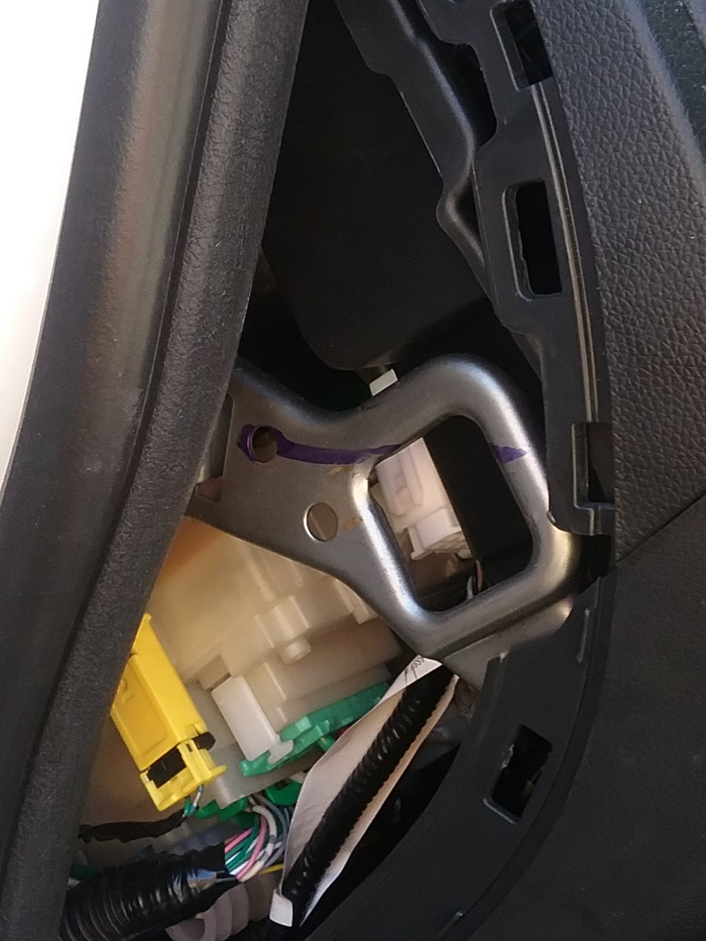 Honda Fit 2016, remove the driver's side lower. After you remove side panel by prying it up. Photo 2 by Don Tai